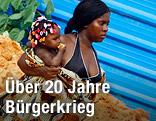 Angolanische Frau mit Kind