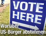"""Schild mit der Aufschrift """"Vote here"""""""
