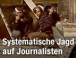 Pressefotografen gehen in Kairo in Deckung