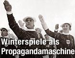 Mitglieder der österreichischen Mannschaft erweisen den olympischen Gruss.(Originaltext) - Februar 1936