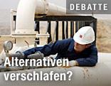 Arbeiter an einer Ölpipeline