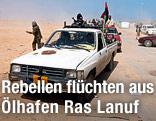 Rebellen flüchten mit einem Auto