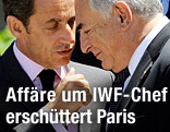 Dominique Strauss-Kahn spricht mit Frankreichs Präsident Nicolas Sarkozy