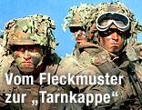 Deutsche Bundeswehr-Soldaten im Kampfanzug mit Gesichtsbemalung und getarnten Helmen