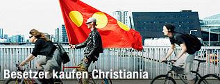 Radfahrer mit Christiania-Flagge