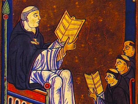 Miniatur die den heiligen Hugo von Sankt Viktor mit aufgeschlagenem Buch von einer Gruppe von Mönchen zeigt