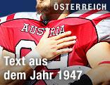 Footballer mit Nationaltrikot und Hand auf dem Herz während der Bundeshymne