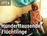 Frau mit Kind in Flüchtlingslager
