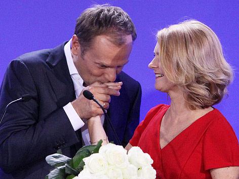 Polens Ministerpräsident Donald Tusk mit Ehefrau