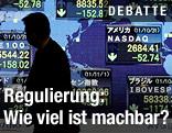 Schatten einer Person vor einer Tafel mit Börsekursen