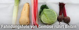 Fahndungsfoto mit Gemüse