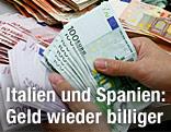 Hand mit vielen Euro-Noten