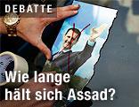 Durchgestrichenes Foto vom syrischen Präsidenten Bashar al-Assad