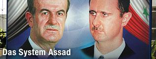 Plakat mit Baschar al-Assad und Hafis al-Assad