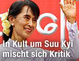 Aung San Suu Kyi winkt nach einer Wahlrede