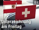 Österreichische und Schweizer Flagge