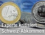 Euro-Münze neben einer Schweizer Franken-Münze mit Franken-Scheinen im Hintergrund