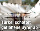 Stacheldrahtzaun vor einem Flüchtlingscamp in der türkischen Provinz Kilis