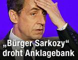 Abgewählter französischer Präsident Sarkozy greift sich an den Kopf