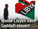 Bub geht an einer Mauer vorbei, auf der eine libysche Fahne und ein Abbild von Gaddafi gesprayed wurden