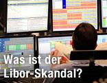 Ein Trader vor Monitoren