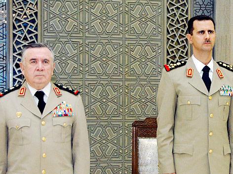 Syriens Leiter der zentralen Krisenstelle, Hassan Turkmani und syriens Machthaber Bashr al-Assad