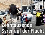 Flüchtlinge mit Gepäck
