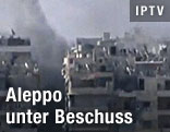 Rauch über Gebäude in Aleppo