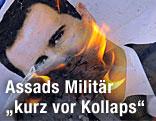 Syrische Rebellen verbrennen das Porträt des syrischen Machthabers Bashar al-Assad