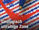 Kugelschreiber zeigt auf Seismographen-Ausdruck