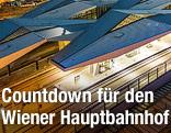Luftaufnahme des Wiener Hauptbahnhofs in der Dämmerung