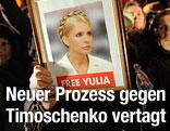 Demonstrant mit Bild von Julia Timoschenko