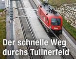 Lokomotive fährt aus einem Tunnelportal auf der neuen Westbahnstrecke