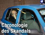 Jean-Claude Mas in einem Polizeiauto