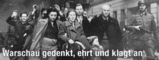 SS-Soldaten treiben Juden durch das Warschauer Ghetto