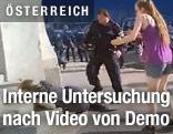 Polizist und Demonstrantin