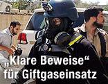 UN-Inspektoren mit Gasmasken