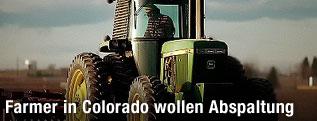Farmer auf Traktor