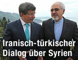 Türkischer Außenminister Ahmet Davutoglu und der iranische Außenminister Mohammed Javad Zarif