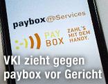 Handy zeigt paybox-Logo