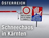Gesperrte Straße mit Hinweisschild Lawinengefahr