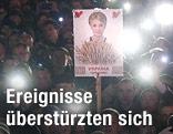 Demonstranten mit einem Timoschenko-Bild