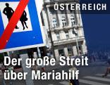 Passanten gehen auf der Mariahilfer Straße in Wien