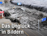 Tsunami-Welle schwappt über Befestigung
