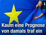 Ein Mann zieht an einer großen EU-Fahne