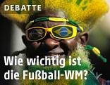 Ein Brasilianer mit grün-gelben Fanartikeln