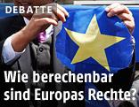 Geert Wilders (Partij voor de Vrijheid) mit zerschnittener EU-Fahne