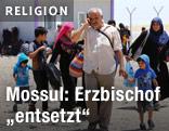 Einwohner von Mosul flüchten vor ISIS-Kämpfern