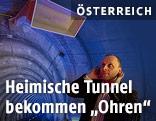"""Franz Graf von Joanneum Research in einem künstlichen Tunnel mit """"Ohren"""""""