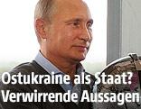 Russischer Präsident Wladimir Putin mit einem Globus